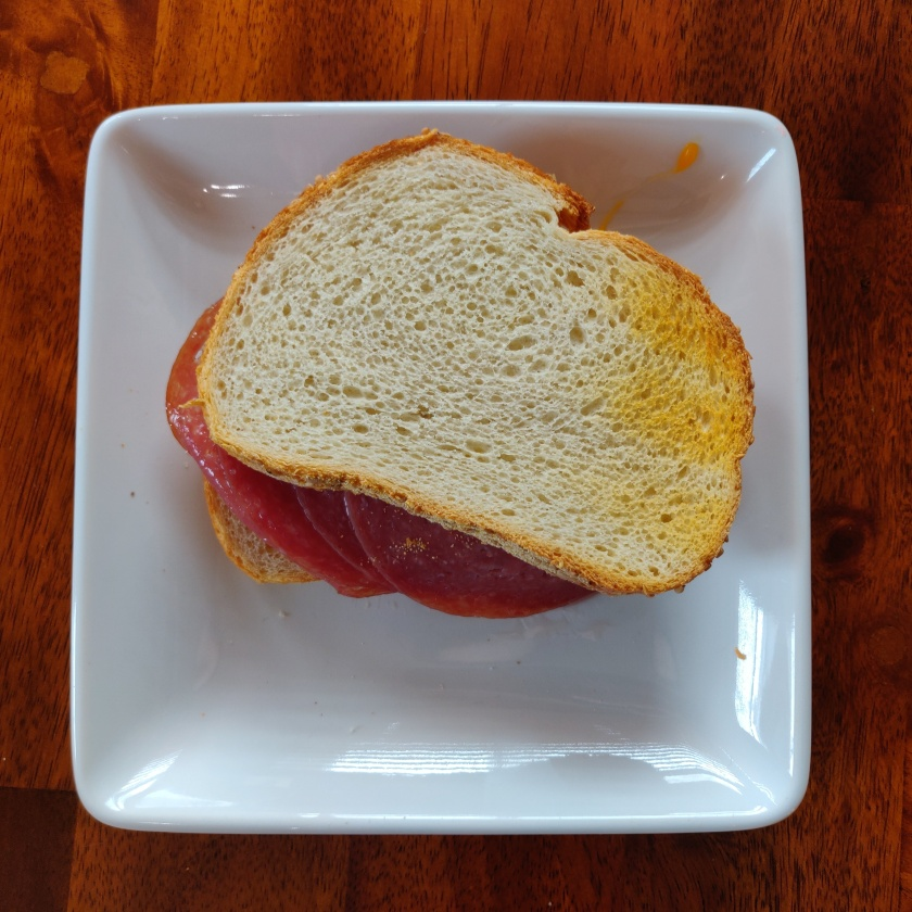 A salami sandwich with toasted Italian bread